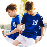 two children playing soccer
