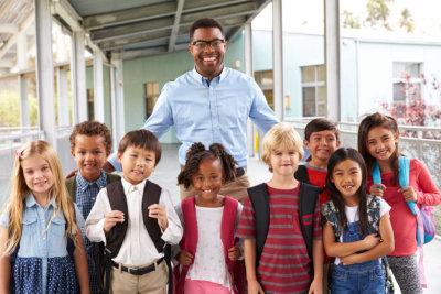 school kids and teacher in corridor